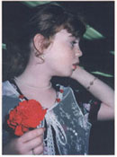 Rachelle with Carnation at matriculation ceremony from elementary school.  Click on image to enlarge.